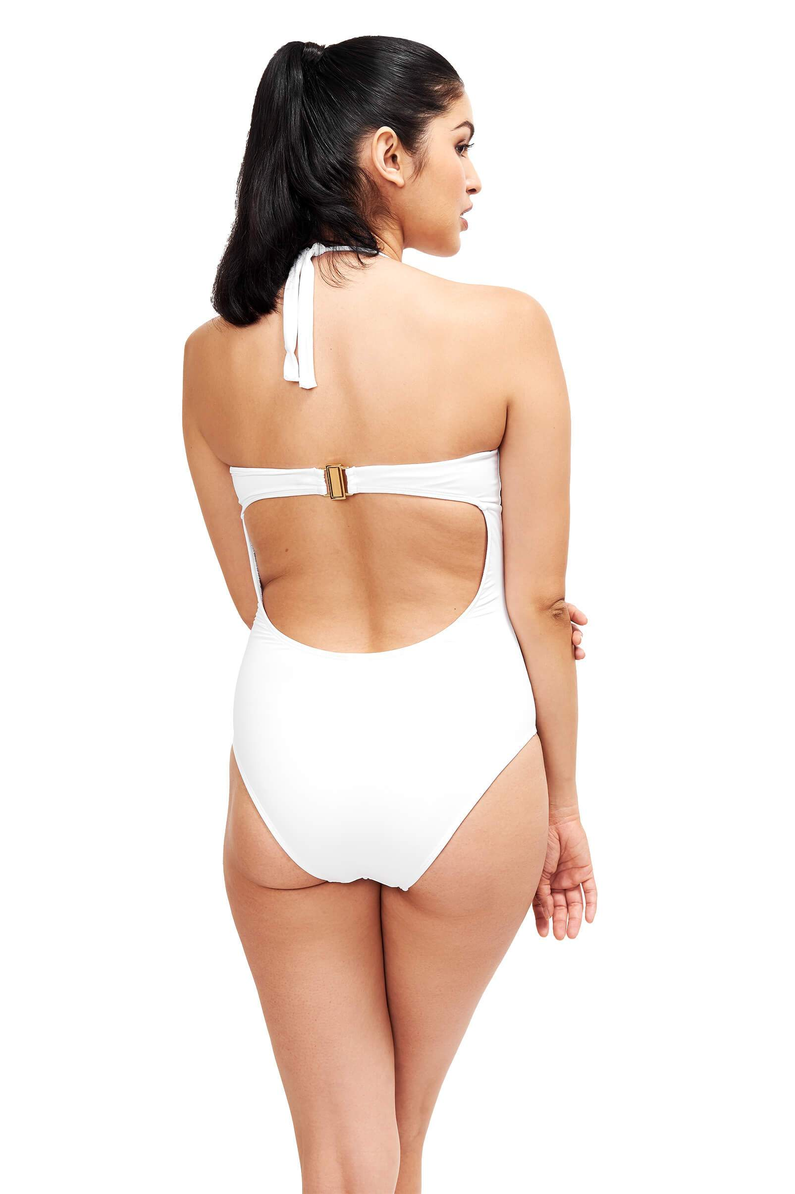 back of model wearing white one piece swim suit with open back and string tie at neck and strap across back
