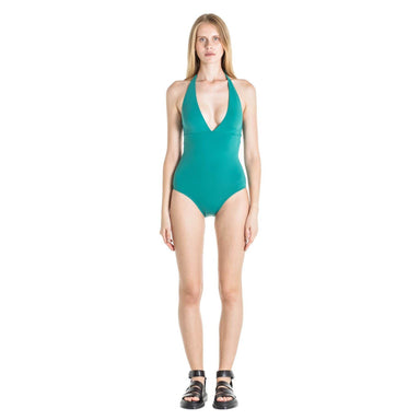 model wearing green one piece with plunging neckline