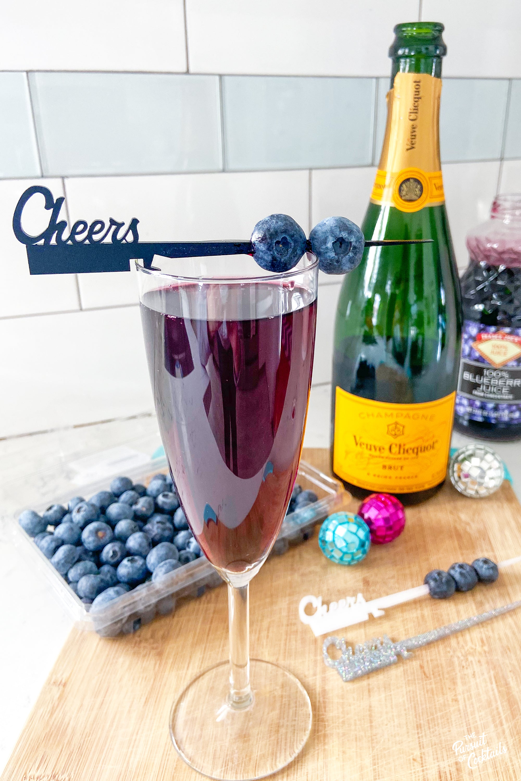 Champagne cocktail using blueberry juice from Trader Joes