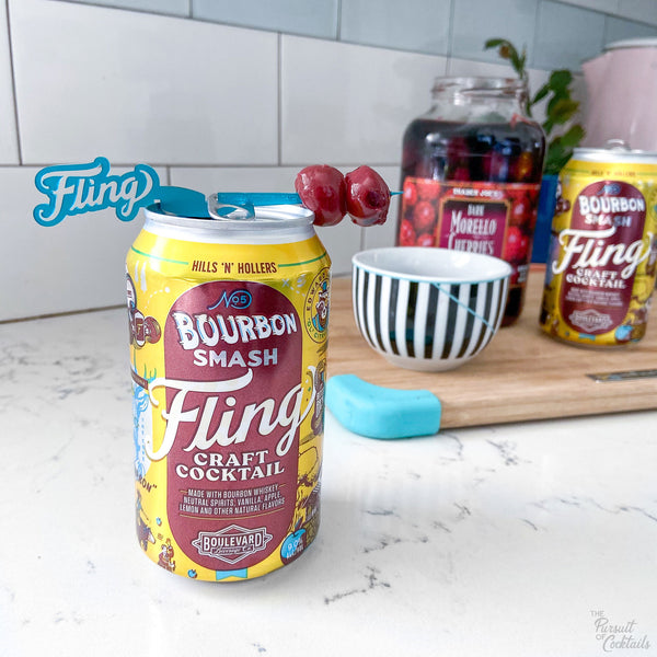 Fling canned cocktail with custom Swizzly Stick by The Pursuit of Cocktails