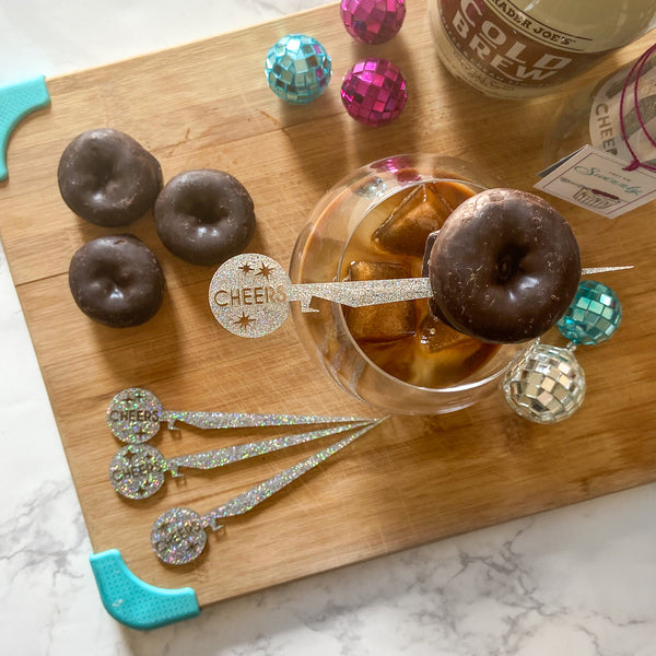 Cheers Swizzly with mini donut garnish on Trader Joe's Cold Brew liqueur