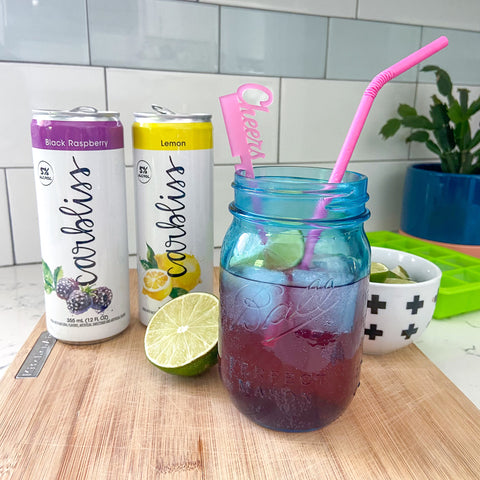 Carbliss canned cocktails mixed and garnished with Swizzly Stick and paper straw from The Pursuit of Cocktails