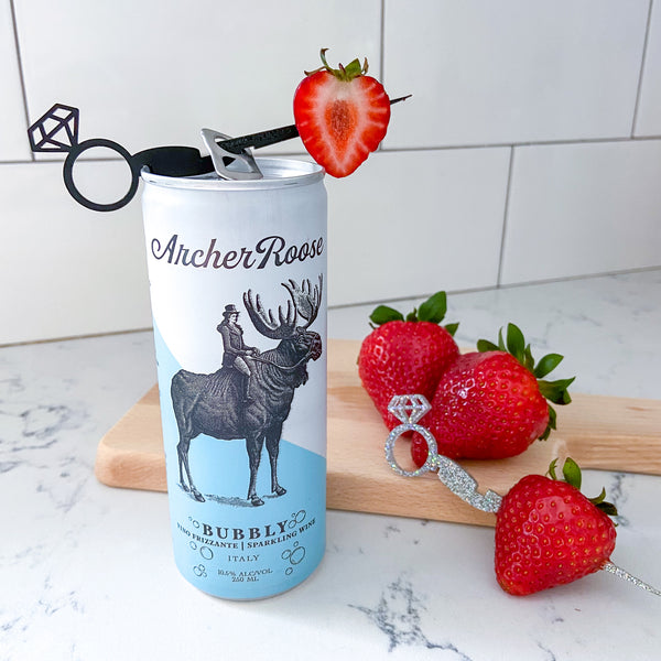 Archer Roose Bubbly reviewed by The Pursuit of Cocktails styled with a diamond ring Swizzly Stick