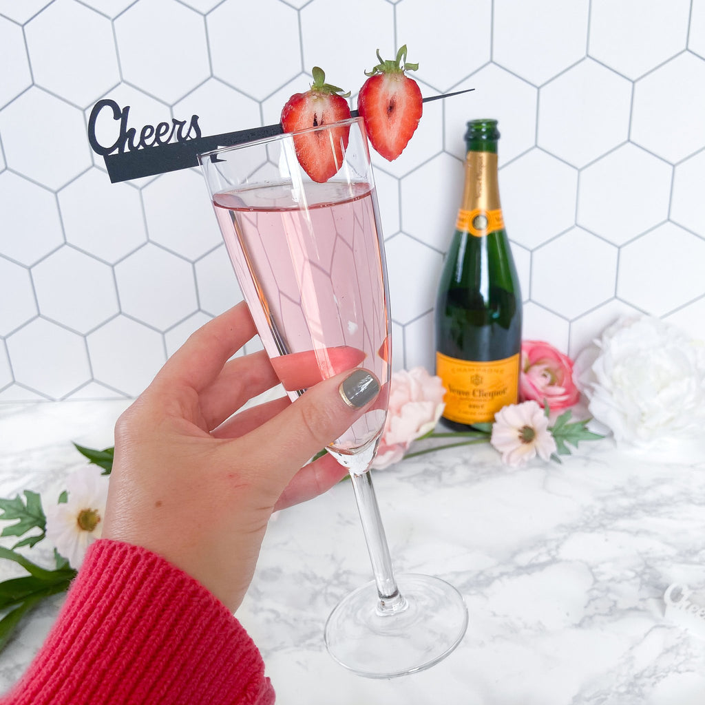 "Fancy cocktail pick ""cheers"" Swizzly in black with notches for new way to garnish drinks"