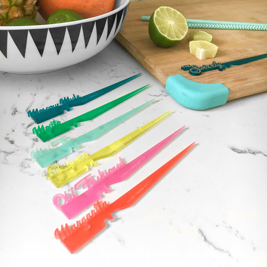 Classic cocktail themed swizzle stick drink markers with patented notch system for securing garnish to the rim of most glasses