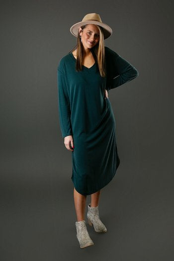 This image shows a long sleeve midi dress available at Gia Rose.