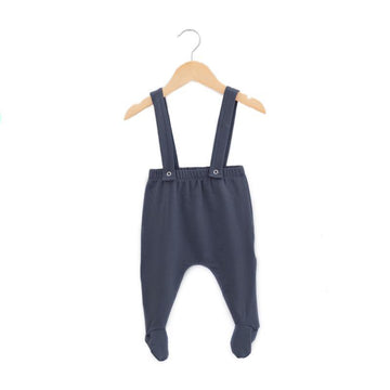 Made with a buttery soft bamboo terry, these footie suspender pants have a harem fit for added comfort. The straps can be crossed or straight in the back and have 2 snap options allowing you to adjust for a desired fit. The straps are also fully removable giving you the option of wearing them as pants without the suspenders.