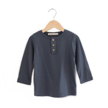 Made with a buttery soft bamboo jersey, this is the perfect tee for both boys and girls. Designed with henley opening and featuring our beautiful coconut buttons.