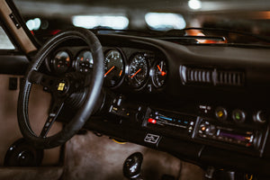 classic car black interior dash and steering wheel