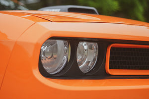 orange classic car front headlight and bumper