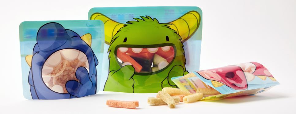Our red, blue and Green Monster bags are perfect for snacks. The red and Blue bags are holding a selection of crispy snacks and the Green Monster Sandwich bag is filled with vegetable sticks