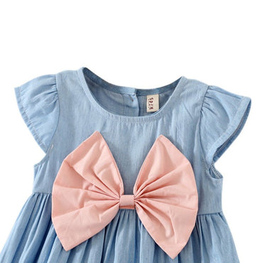 Cute baby girl wearing bow design mini dress