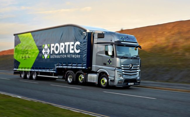Pallet distribution of gravel parking grids via Fortec