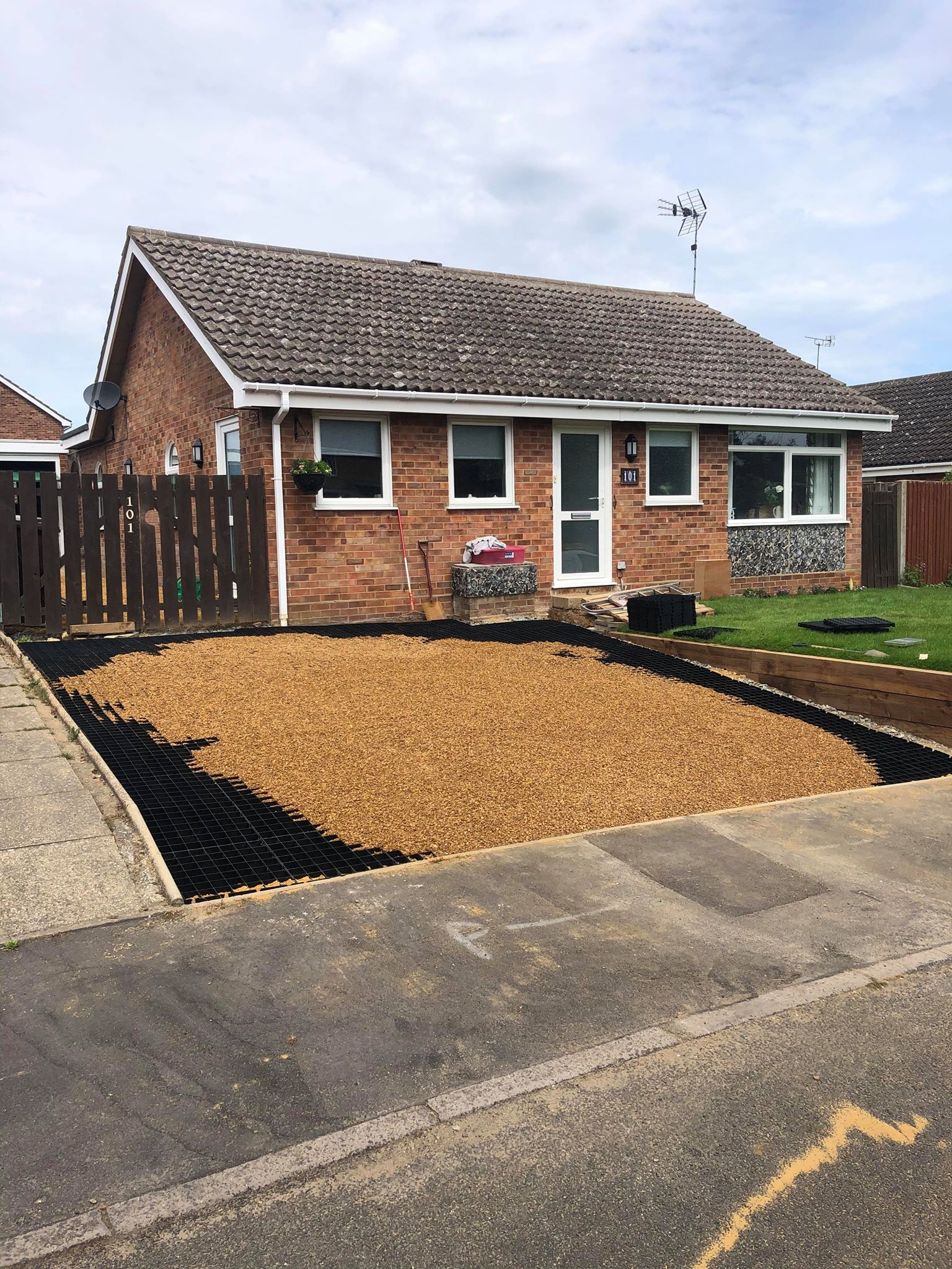 Low cost gravel driveway option using ibran gravel grids
