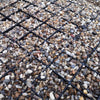 ground reinforcement mat with gravel driveway surface