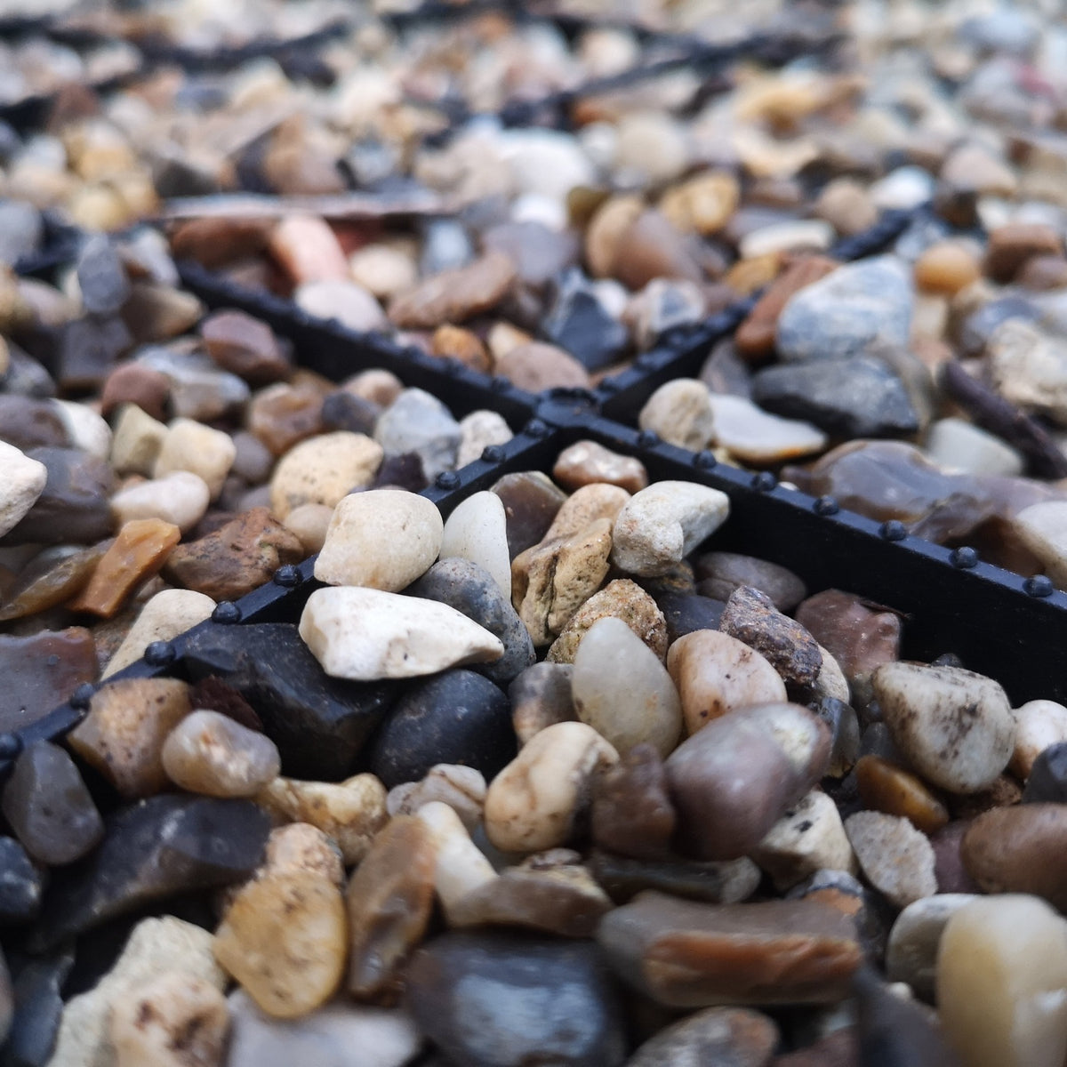 gravel driveway mat filled with stone pebbles