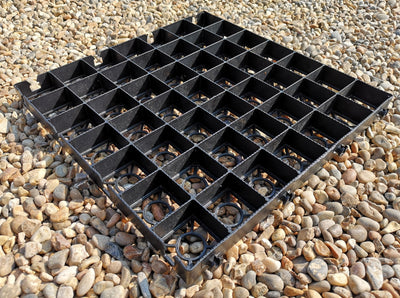 Recycled plastic gravel parking grid.