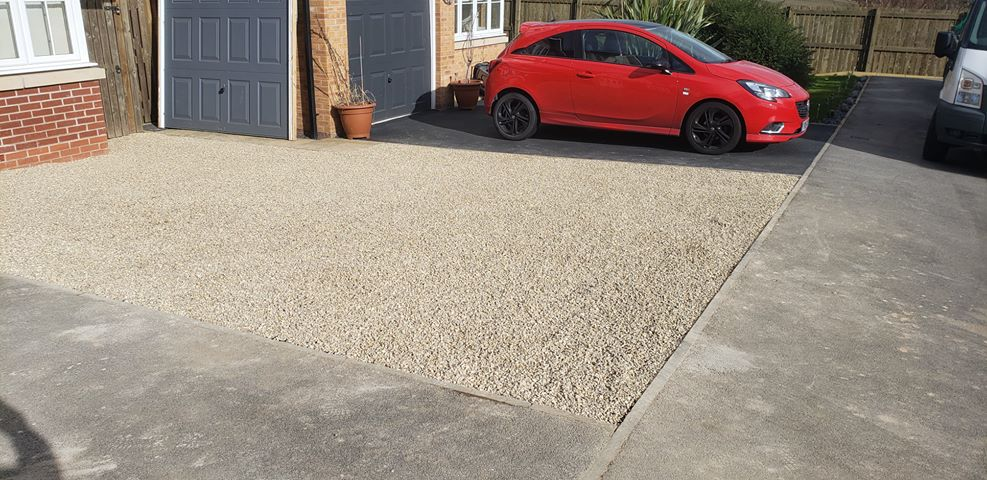Customer driveway installed with gravel parking grids