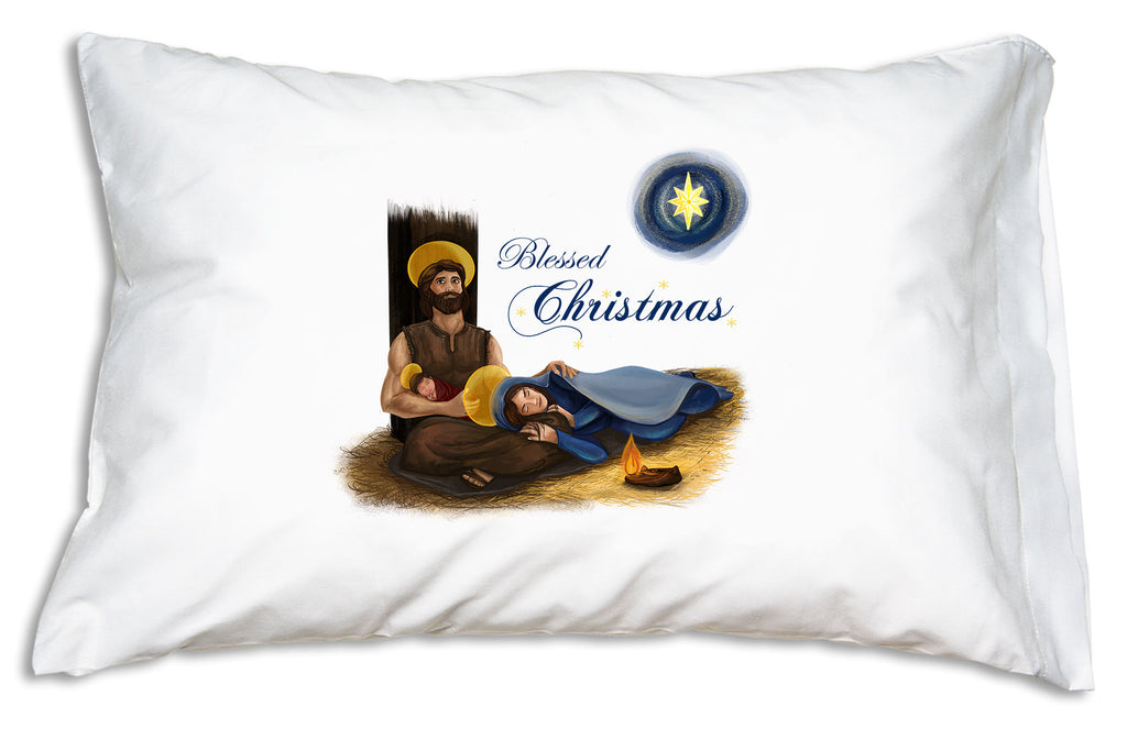 "Festive script proclaiming ""Blessed Christmas"" complements the comforting scene for our Holy Family Blessed Christmas Prayer Pillowcase."