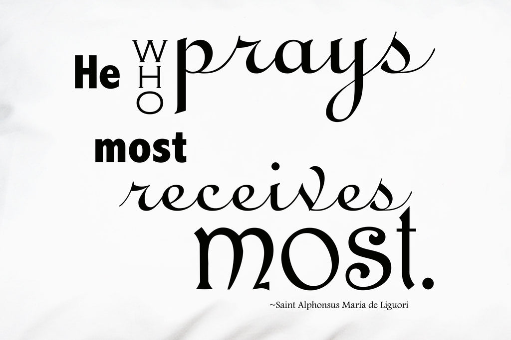 A closeup of St. Alphonsus Liguori's quote on praying.
