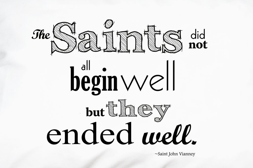 Closeup of St. John Vianney quote about saints.