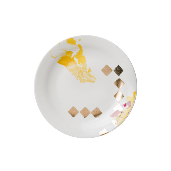 dot design with gold on porcelain plate