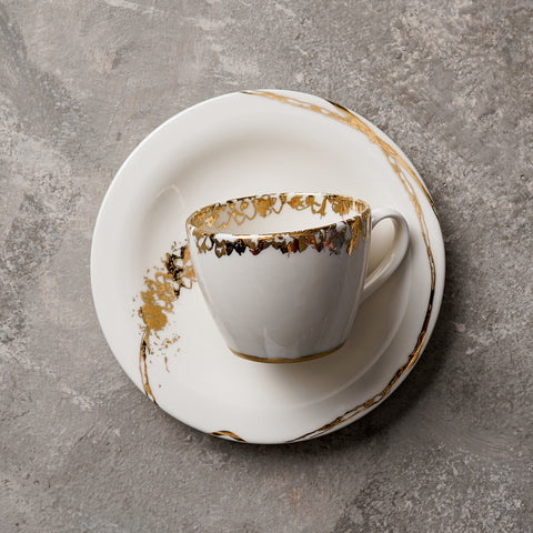Porcelain coffee set with golden decoration inspired from Arabian Desert flower. Coffee Cup & Saucer