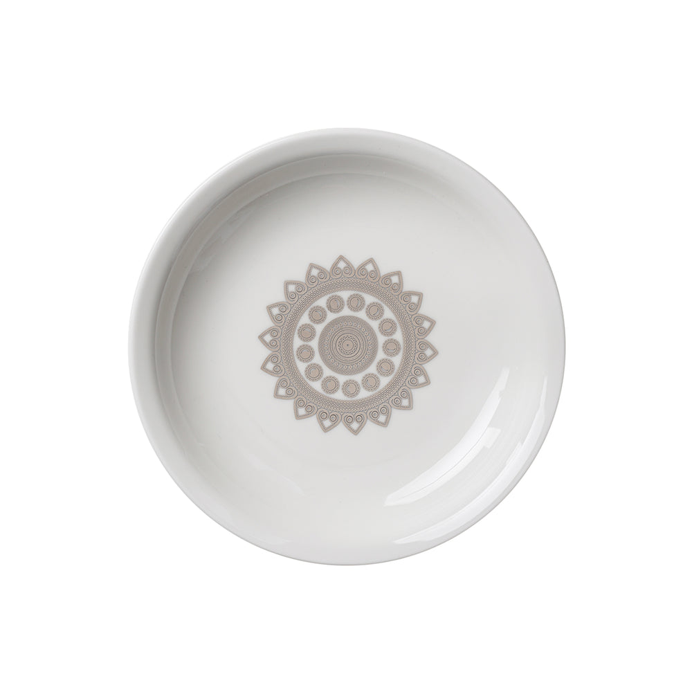 silver design on soup plate