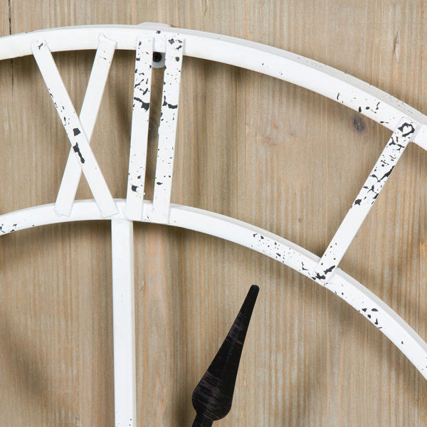 White metal clock by Homania