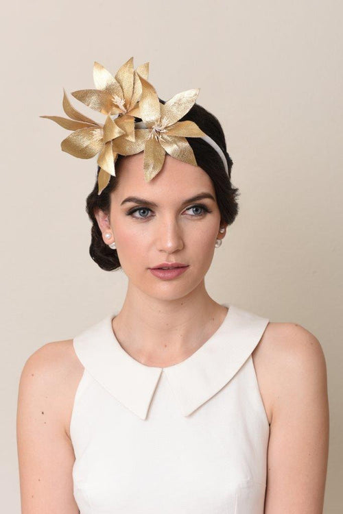Lilies Afloat in Gold Leather: