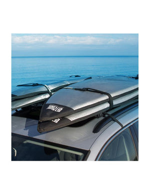 Soft Racks Double System Multiple Board Carrier for Car Roofs On Van at the Beach with Four Surfboards Loaded On Top