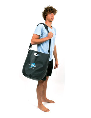 Surflogic Logic Bucket Shoulder Strap System Used by a Surfer After a Surf