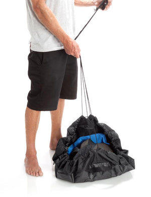 Surfer Using the Surflogic Change Mat Drawstring Bag Feature