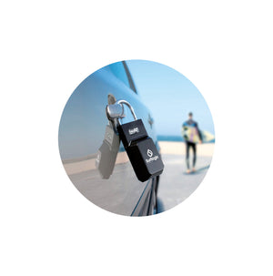 Surflogic Standard Black Key Vault Car Key Security Lock Box Secured on Car Door Handle and Surfer walking with Shortboard to Surf at the Beach