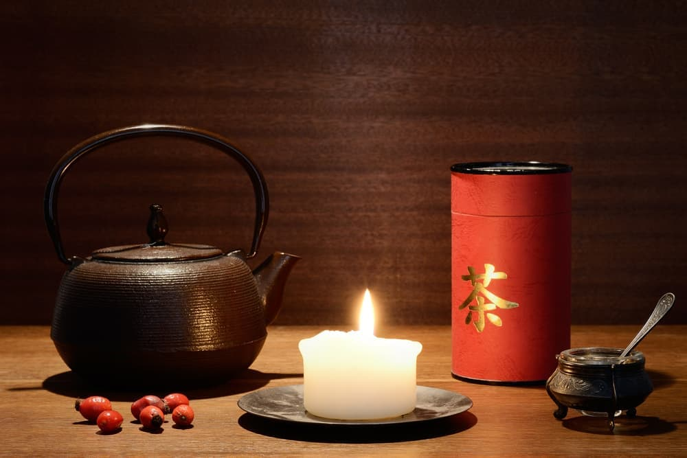 japanese medicine pot of tea and mixture of herbs