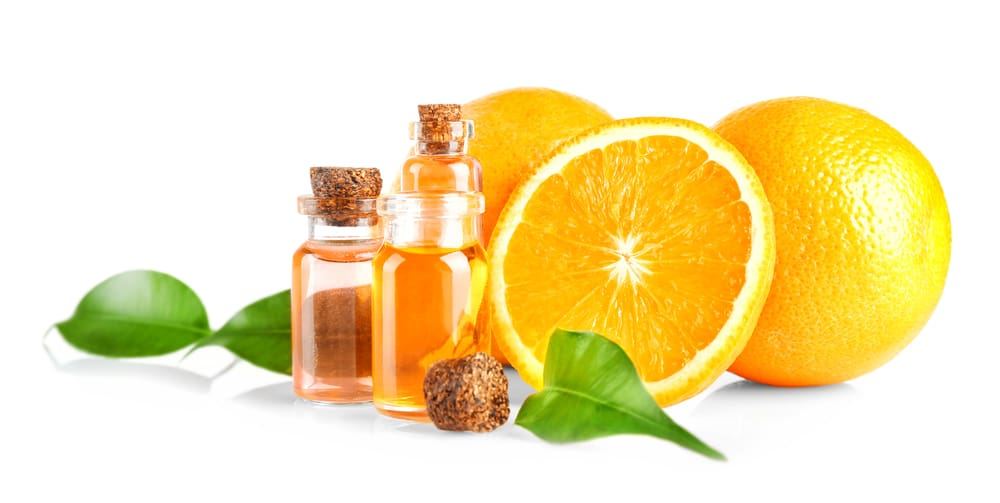 Oranges, leaves and bottles with essential oil