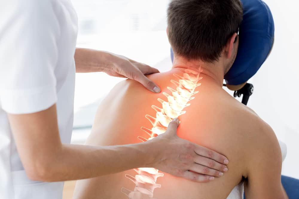 man getting physiotherapy on spine