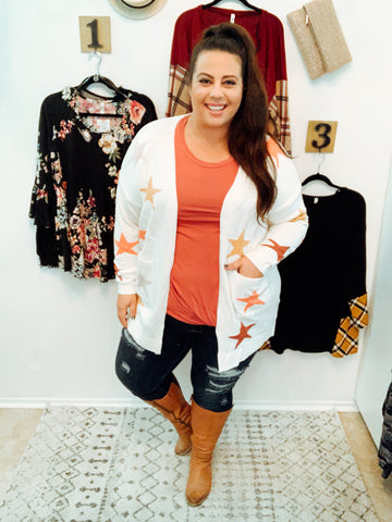 Callie in the you're one of a kind star cardigan and jeans