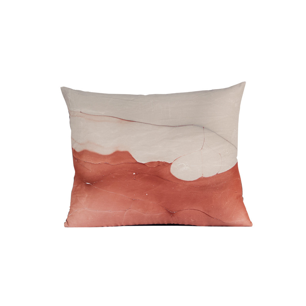 red and tan throw pillow