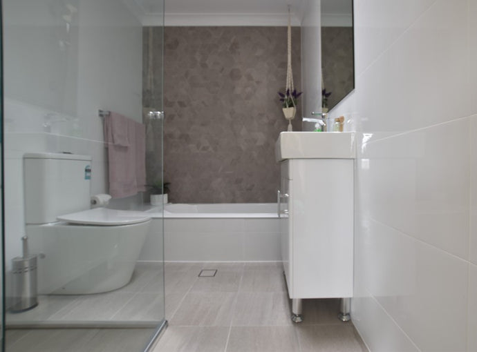 #75 - Bathrooms: Light and bright floors contrast against a cube feature
