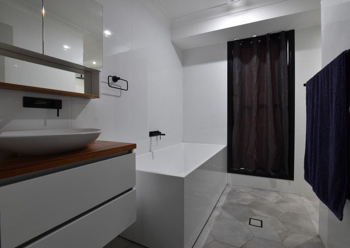 #77 - Bathrooms: Hexagonal floors with all-white walls and a bright inviting atmosphere