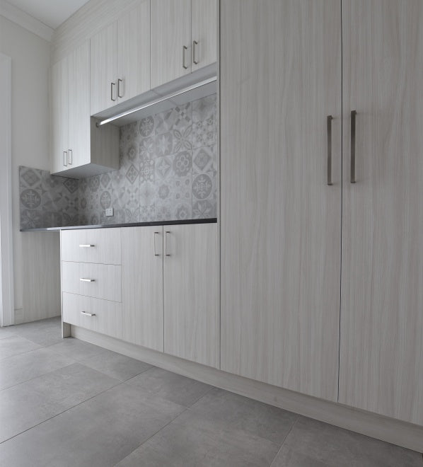 #78 - Laundries: Encaustic look tiles adorn a laundry splashback by Trio