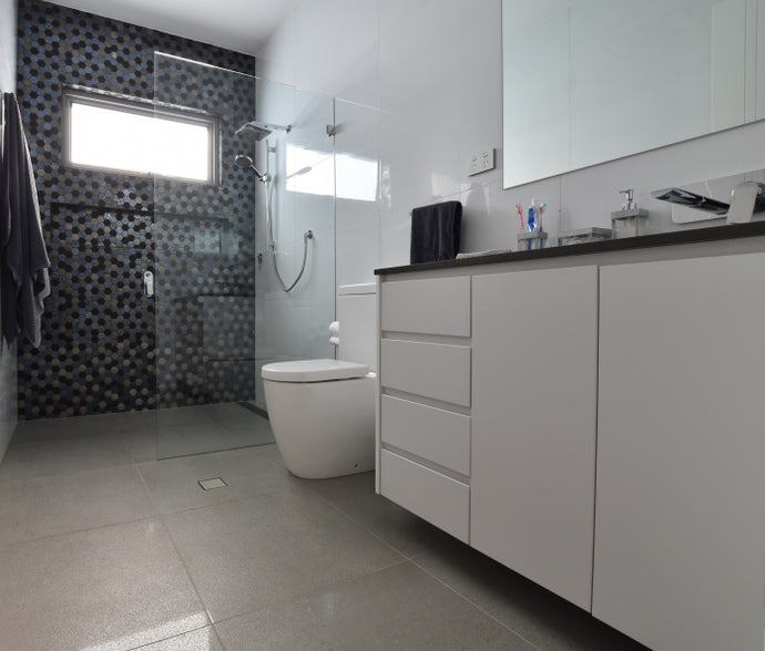 #80 - Bathrooms: Hexagonal mosaic feature wall against a simple all-white