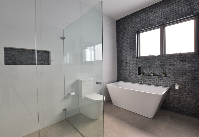 #81 - Bathrooms: A stunning metallic tile laid in brick pattern adorns the feature wall