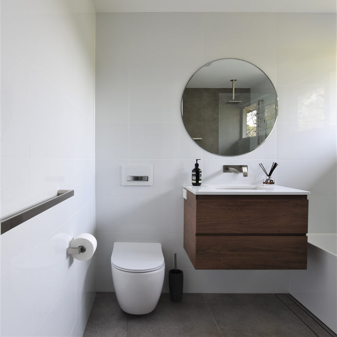 #82 - Bathrooms: Concrete grey with timber coloured vanity and all-white walls by Jenny