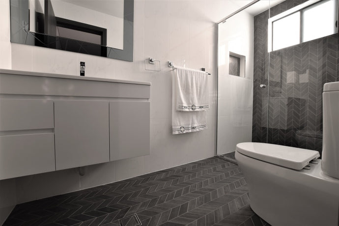 #85 - Bathrooms: Chevron (arrow) mosaics run throughout the floor and a feature wall