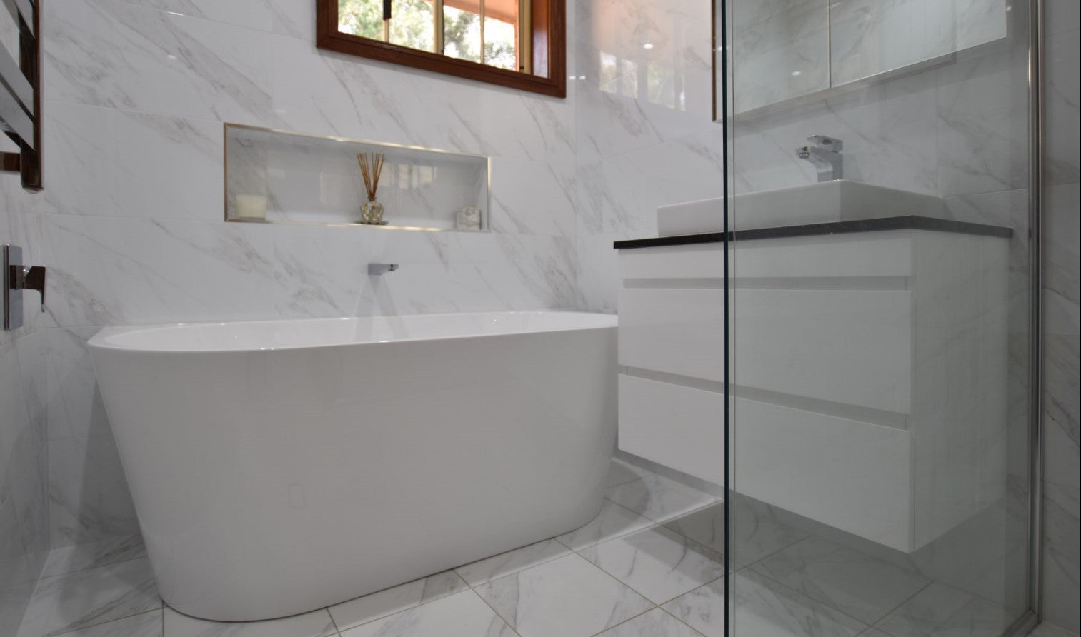 Deanne's bathroom features a back to wall bath tub, much easier to clean as there are less gaps