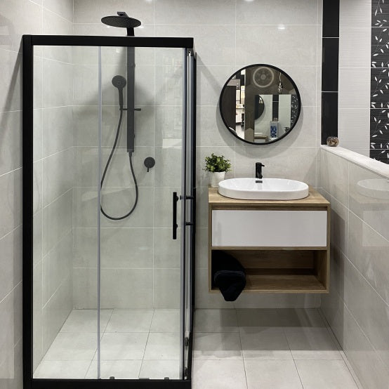 Display bathroom with black frame mirror, black 2 in 1 shower, black screen and open shelf wall hung vanity