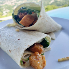 Vegan Buffalo Tofu Wrap with Lettuce, Carrots, Cucumber, Black Beans