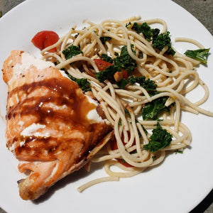 Salmon over Brown Rice Spaghetti with Kale, Garlic, Cherry Tomatoes